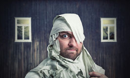 Man in toilet paper in neglected room Stock Photos