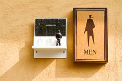 Man toilet sign. On the red brown background Stock Photo