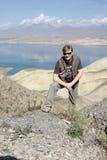 Man and Toktogul Reservoir Royalty Free Stock Photos