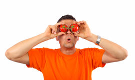 Man with tomatoes on his eyes Royalty Free Stock Images