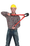 Man with tongs Royalty Free Stock Image
