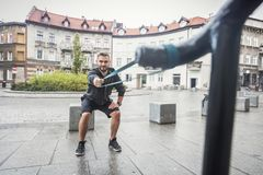 Man toning his body in an outdoor city training. Stock Photo