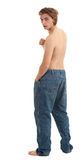 Man in too big trousers Stock Image