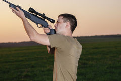 Man took aim with your sniper rifle Royalty Free Stock Photo