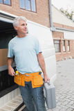 Man with tool belt and briefcase by van Stock Photography