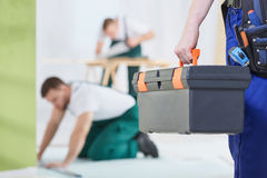 Man with tool box. Close-up of men in uniform holding tool box royalty free stock photo
