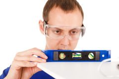 Man with tool level isolated in white background. Stock Photos
