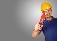 Man tool on white background 02. Isolated standing young worker with space for text Royalty Free Stock Images