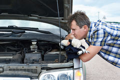 Man with tools near broken car Stock Images