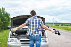 Man with tools near broken car Royalty Free Stock Photo