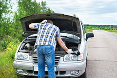 Man with tools near broken car Royalty Free Stock Photos