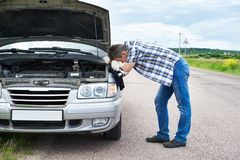 Man with tools near broken car Stock Photography