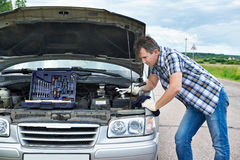 Man with tools near broken car Royalty Free Stock Photography