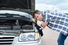 Man with tools near broken car Stock Image