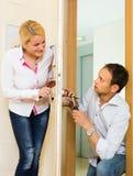 Man with tools repairing door lock Stock Photography