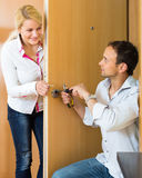 Man with tools repairing door lock Stock Photo