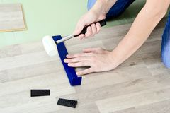 Man with Tools to Laying Laminate Stock Photography
