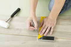 Man with Tools to Laying Laminate Royalty Free Stock Image