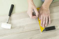 Man with Tools to Laying Laminate Royalty Free Stock Photo