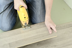 Man with Tools to Laying Laminate Stock Photos
