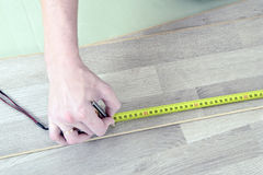 Man with Tools to Laying Laminate Stock Images