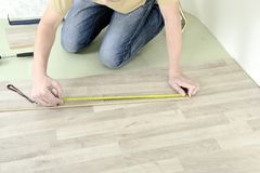 Man with Tools to Laying Laminate Stock Photo