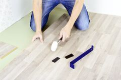 Man with Tools to Laying Laminate Royalty Free Stock Images