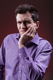 Man with tooth pain. Young man suffering from severe tooth pain Stock Images