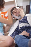 Man with toothache and bandage Stock Image