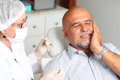Man with toothache at the dentist Royalty Free Stock Photography