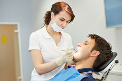 Man with toothache at dentist Royalty Free Stock Images
