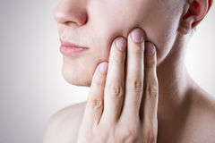 Man with a toothache. Pain in the human body Royalty Free Stock Image
