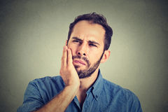 Man with a toothache tooth pain. Young man with a toothache tooth pain royalty free stock images