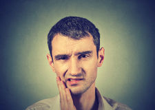 Man with a toothache tooth pain. Young man with a toothache tooth pain royalty free stock photos