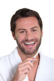 Man with toothbrush Stock Image