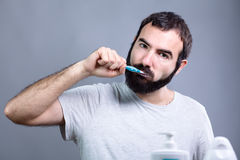 Man with Toothbrush Stock Images