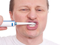 Man with toothbrush is cleaning his teeth Royalty Free Stock Photos