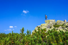 Man on top of a boulder Royalty Free Stock Image