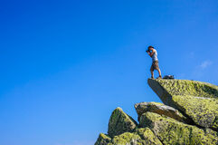 Man on top of a boulder Stock Photography