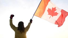 Man on the top with Canadian flag. Winner and motivation concept royalty free stock photo