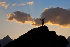 Man on the top of a cliff at sunset Royalty Free Stock Photography