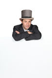 Man in a top hat. With a blank board Stock Photos