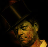 Man with top hat and bloody face stock photo