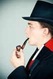 Man in top hat smoking a pipe Royalty Free Stock Photo