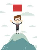 Man on the top holding flag. Royalty Free Stock Photography