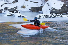 Man On Top of Ice Flow In Orange Kayak Stock Photos