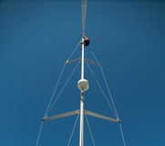 Man in top of mast. Man in the top of a mast reparing it Stock Images