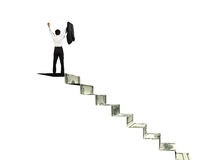 Man on top of money stairs cheering Stock Photo