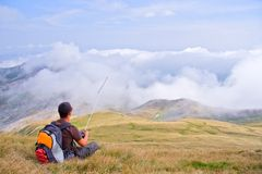 Man on a top of the mountain Stock Images