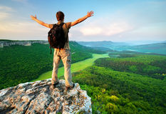 Man on top of mountain Stock Images